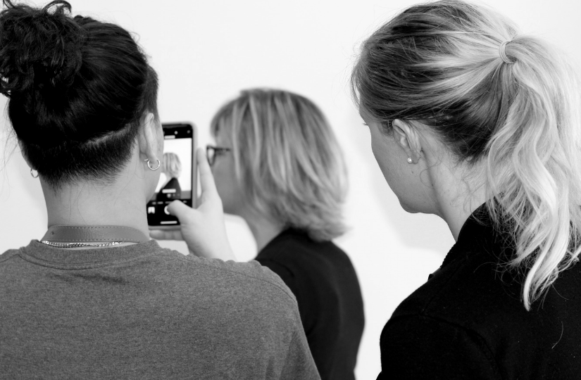 Hair school student taking photo of client