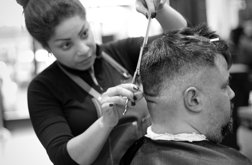 barber student doing scissor hair cutting techniques