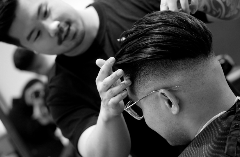barber student styling his client hair