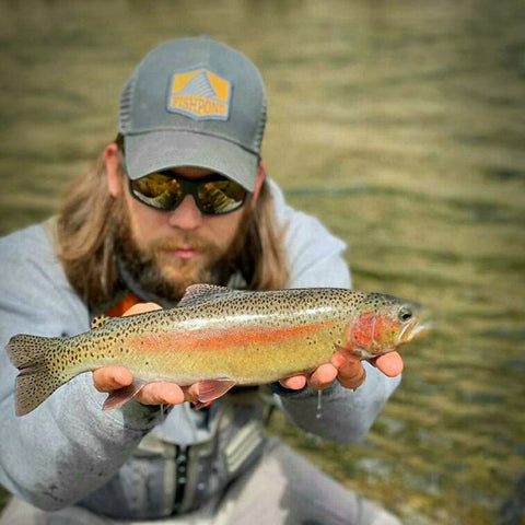 Miles holding a Truckee River Rainbow