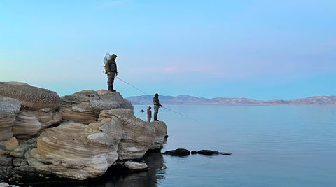 Pyramid Fly Fishing for Lahontan Cutthroat Trout standing on rocky shoreline
