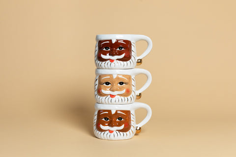 Cocoa Santa Mugs in Chocolate, Honey, and Caramel stacked on top of one another
