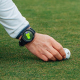 Golfer wearing the GOLFBUDDY aim W11 GPS while lining up a TaylorMade TP5 pix