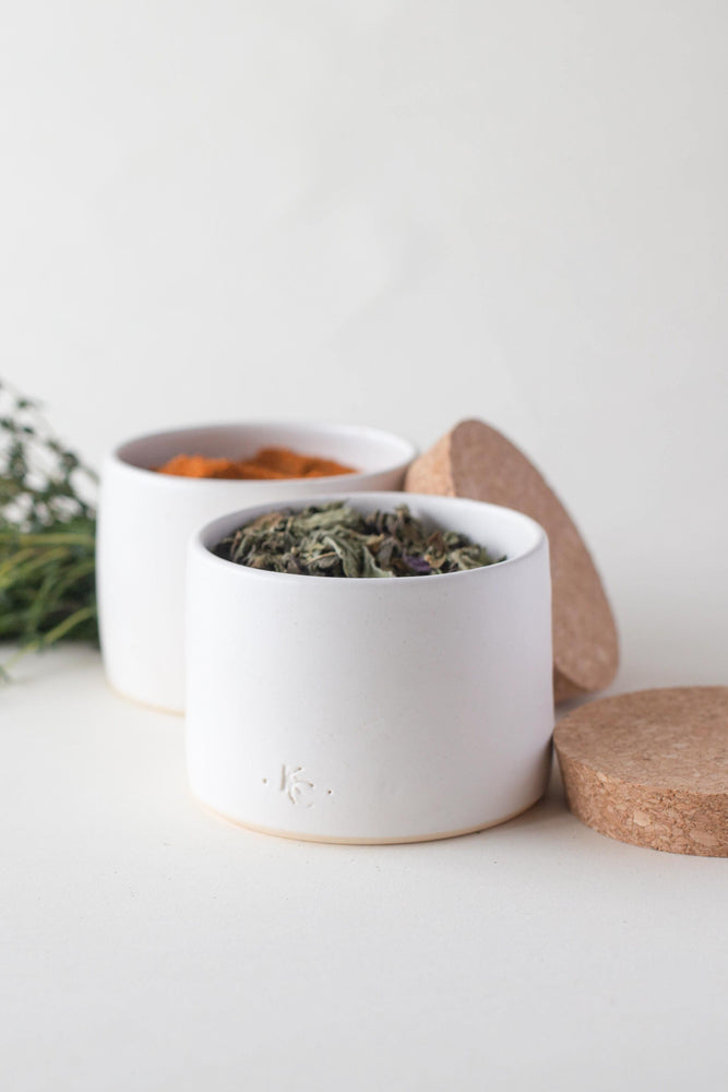 A handthrown ceramic herb pot in our Kinship Collection off-white glaze.