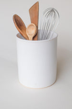 A handthrown ceramic utensil crock in our Kinship Collection off-white glaze.