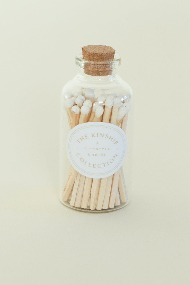 An apothecary match bottle with cork top.