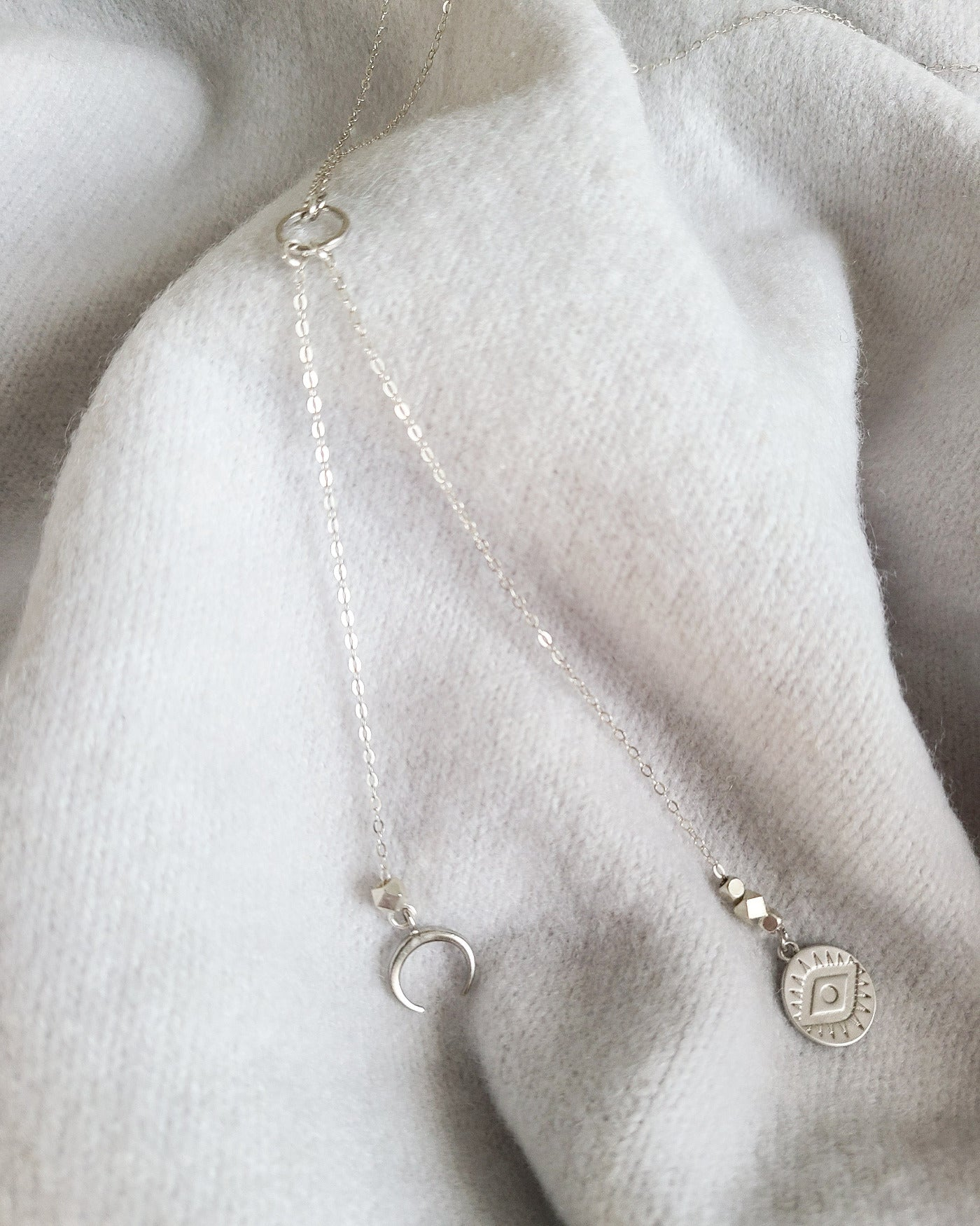 "Your Darkness Defines The Light Necklace is a total of 31.5 inches long. It features a long delicate sterling silver chain and two small 12cm silver charms (Evil Eye and Crescent Moon).   It is 26"" to the round connector and an additional 5.5"" drop from the connector."