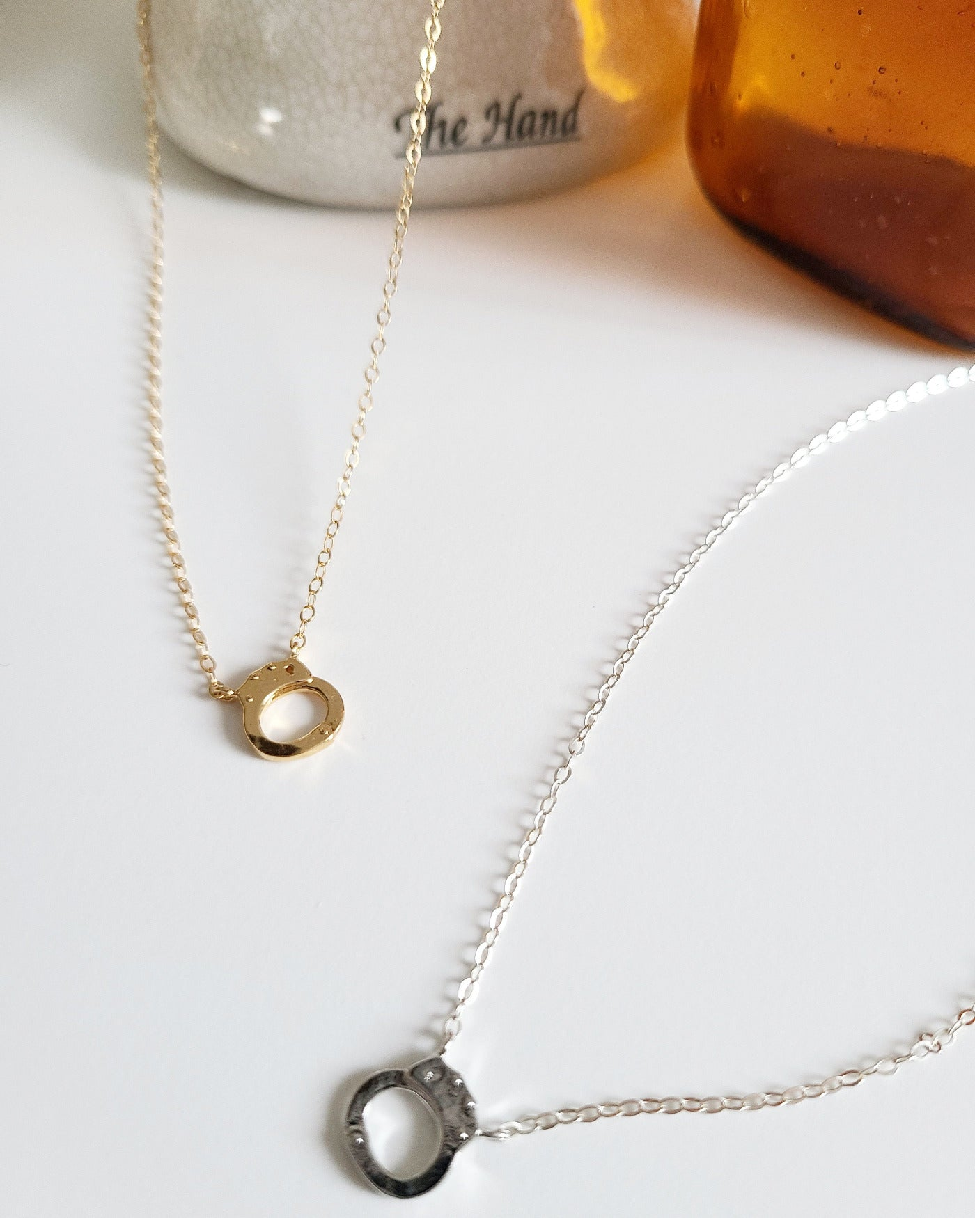 "Your Taking Control Necklace is available in both 18"" gold vermeil or 18"" sterling silver dainty chain with a tiny lobster clasp closure. Features a small 7cm handcuff charm."