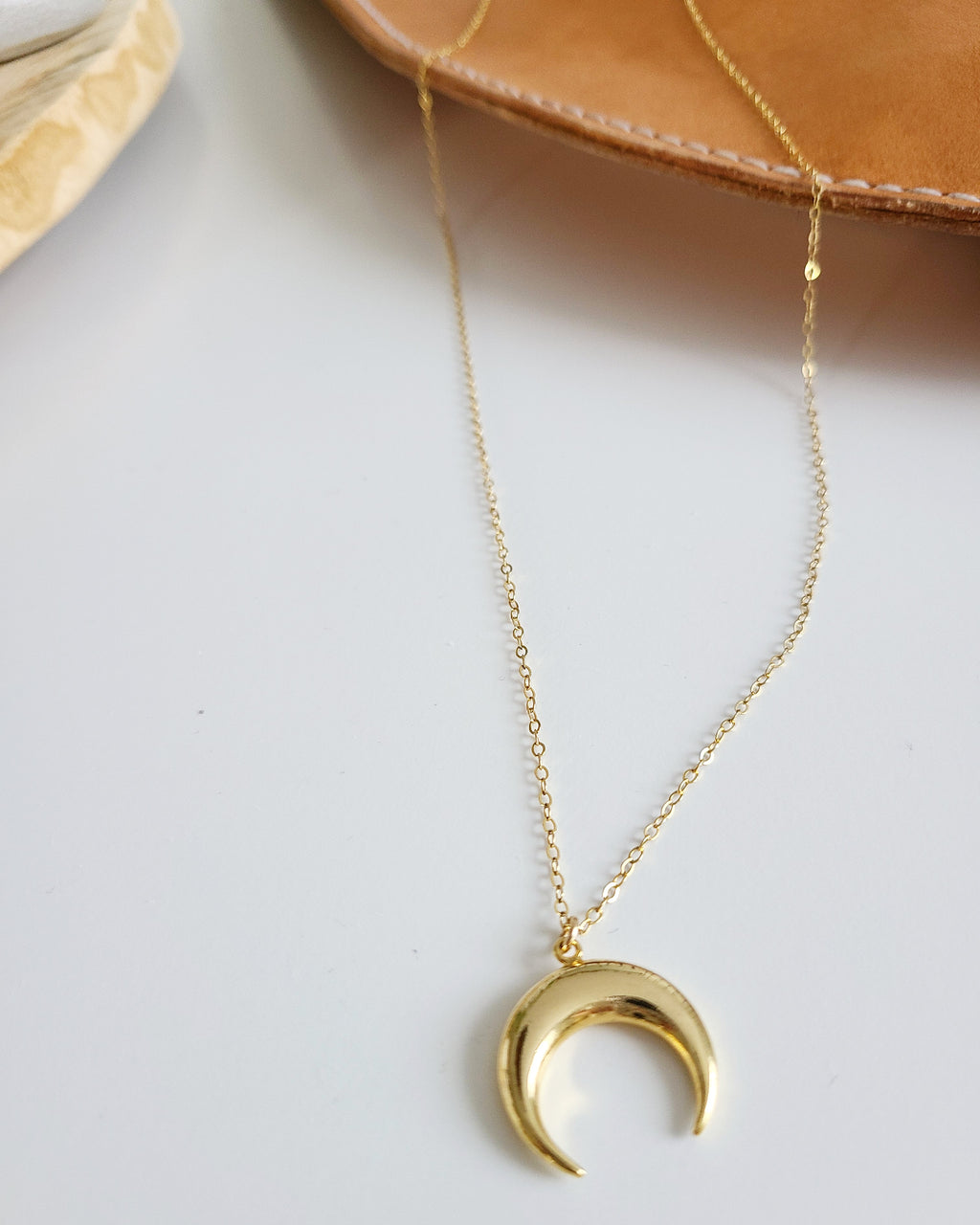 "Choose from a 26"" long dainty gold vermeil chain with a 14cm gold crescent moon. This length slips over with ease and requires no clasp."