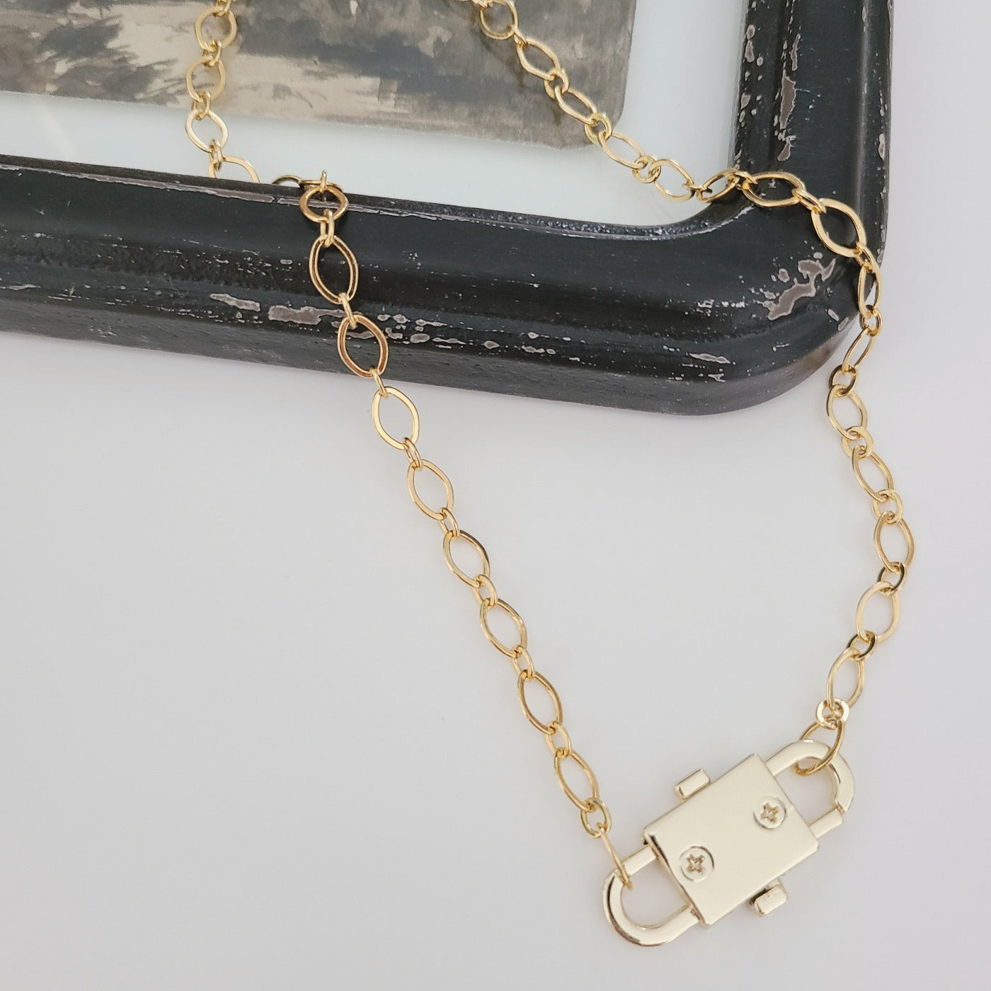 "Cool, Minimalist, unique and just the right amount of edge. Perfect on its own or layering it up. 14 or 16"" gold fill chain with double sided clasp. Clasp is 1 1/4"" long."