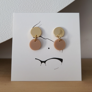 18k gold fill earrings with sterling silver posts and a small round taupe acrylic matte charm. Earrings are approx 1 inch long.