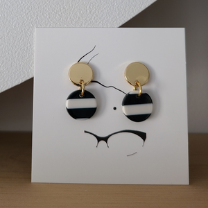 18k gold fill earrings with sterling silver posts and a black and white striped resin charm. Earrings are approx 1 inch long.
