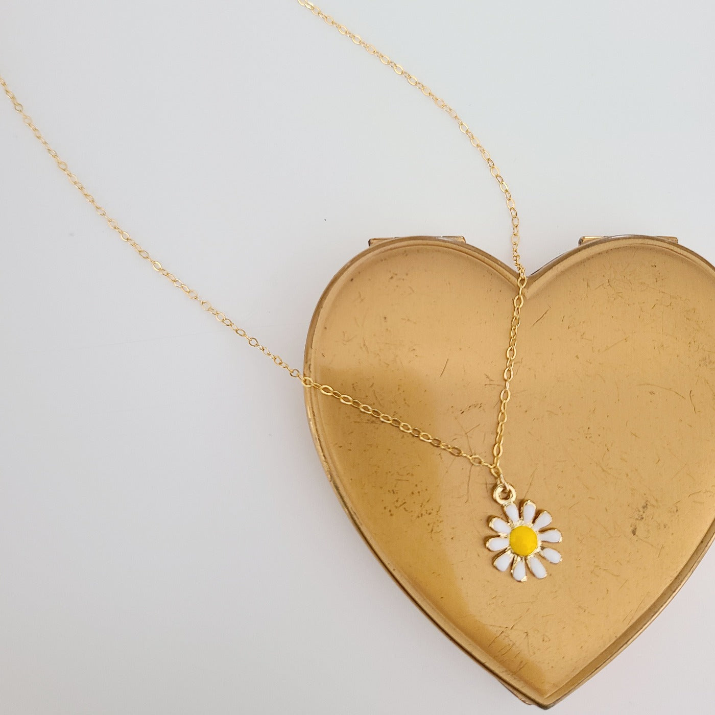 The A Daisy for Helen Necklace is a lovely white epoxy daisy pendant on a delicate,  gold vermeil chain with tiny lobster clasp. This necklace is available in both 16 inch and 18 inch lengths.