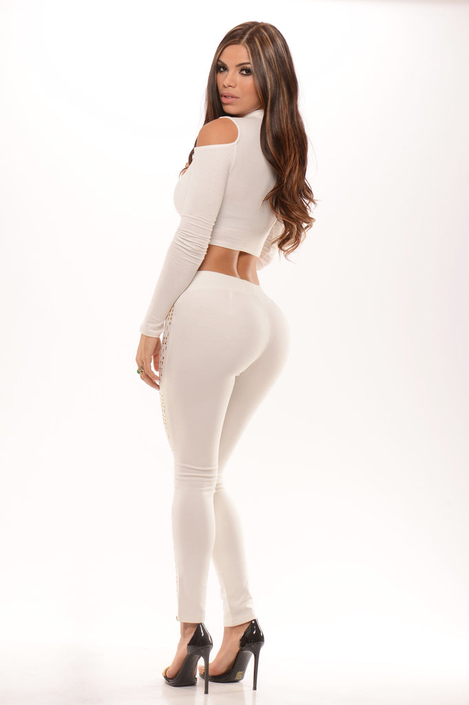 White leggings with gold details