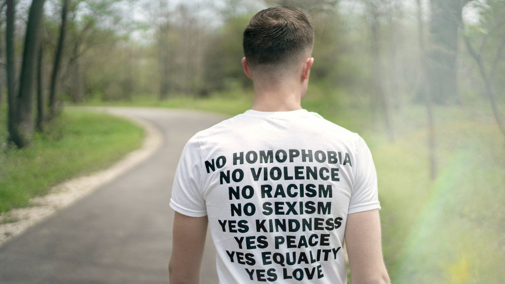 Man wearing t-shirt with equality slogans