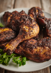 The world famous At Home by Myristica Jerk Chicken - prepared using four different steps including smoking and marinading - this is a real Caribbean treat!