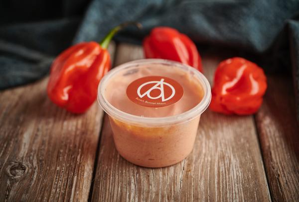 Fancy a kick to your Caribbean dining?  Try the At Home by Myristica Scotch Bonnet Mayo with your meal kit today!