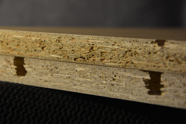 Particleboard grades being compared