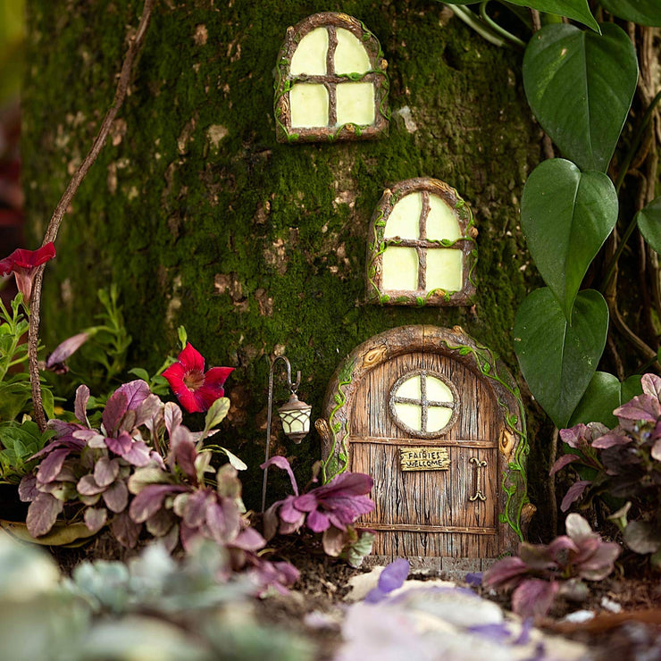 Fairy home door with glowing windows and lamp