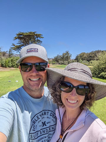 Chris and Annie playing golf
