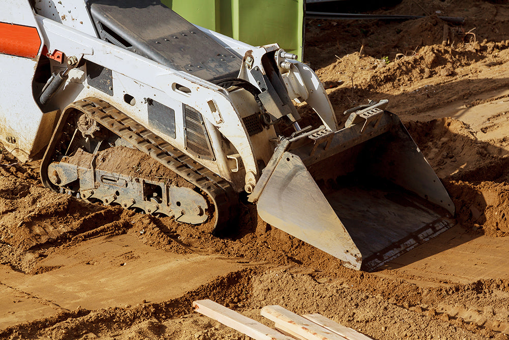 Backyard always wet? We can fix it - Bobcat Mini Track Loader