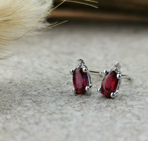 Oval ruby and diamond stud earrings