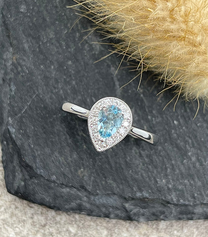 Pear shaped halo aquamarine ring