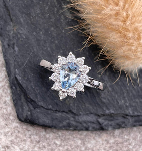 Pear shaped aquamarine cluster ring