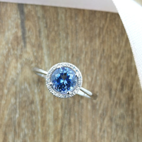 Round tanzanite halo ring