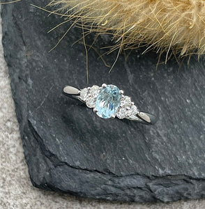 Oval aquamarine trefoil diamond ring