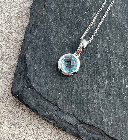 Checkerboard cut blue topaz pendant