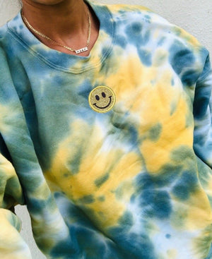 Marigold Smiley Patch Tie Dye Crewneck - Youngwildandserene