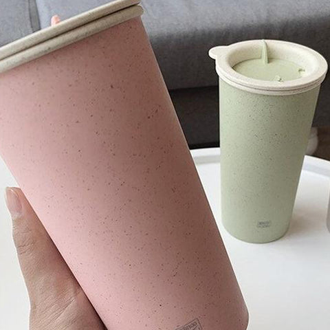 Someone holding a biodegradable cup - Earthy Traditions