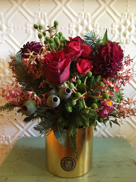 Christmas Arrangement In A Gold Ceramic Pot