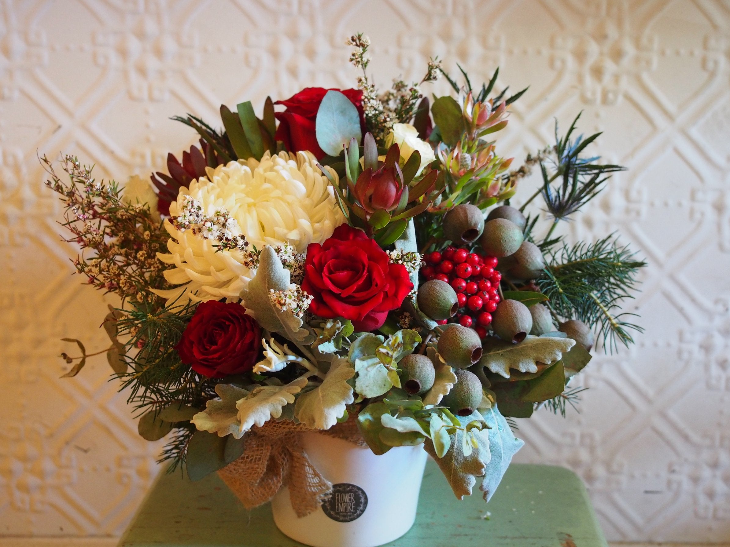 Christmas Arrangement In A White Ceramic Pot