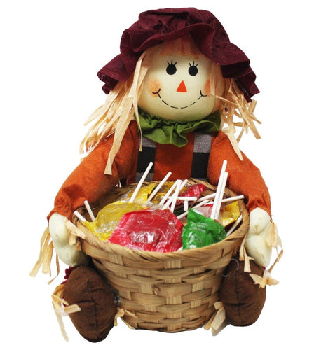 Super Cute Sitting Scarecrow with Basket full of Caramel Apple Pops Harvest Candy front view