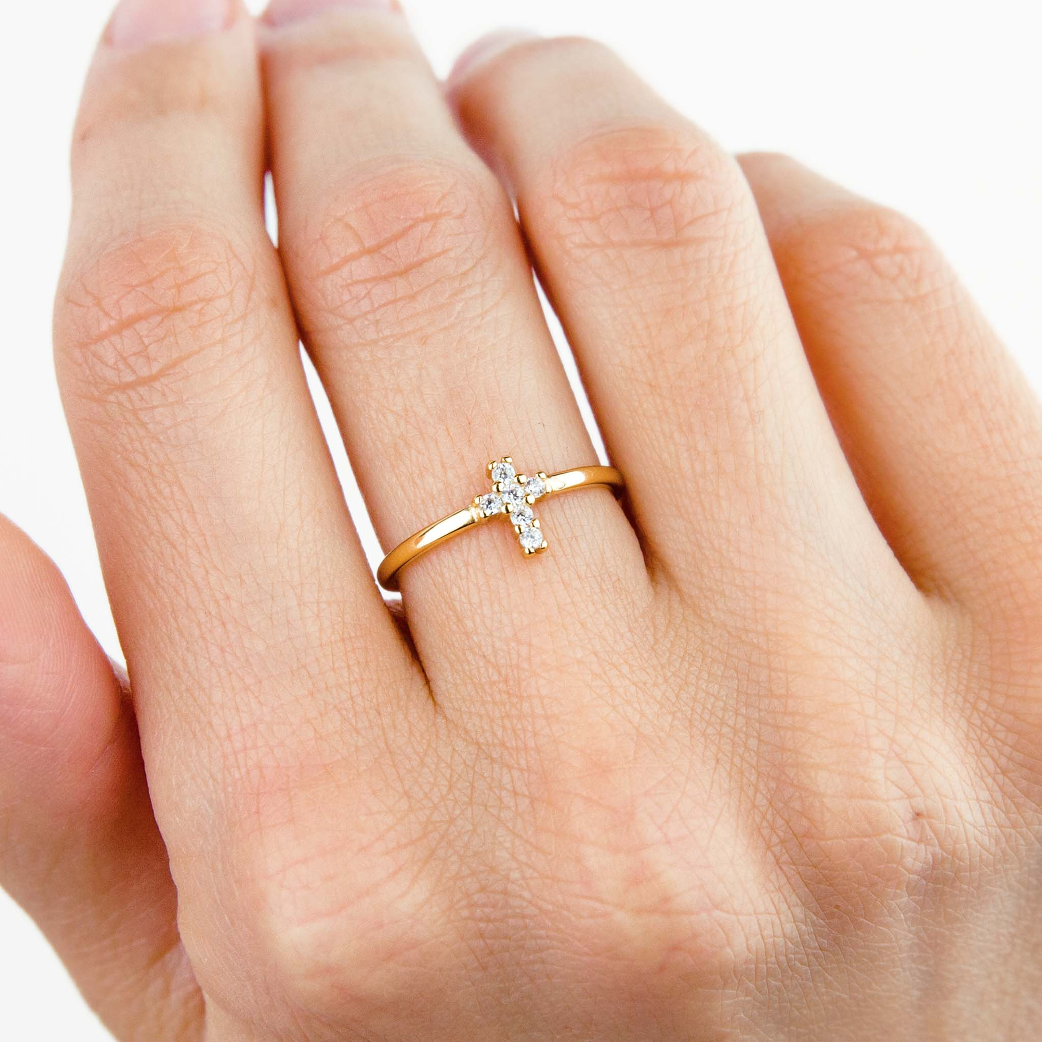 Gold sparkly cross ring