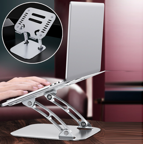 a silver laptop placed on an adjustable laptop stand