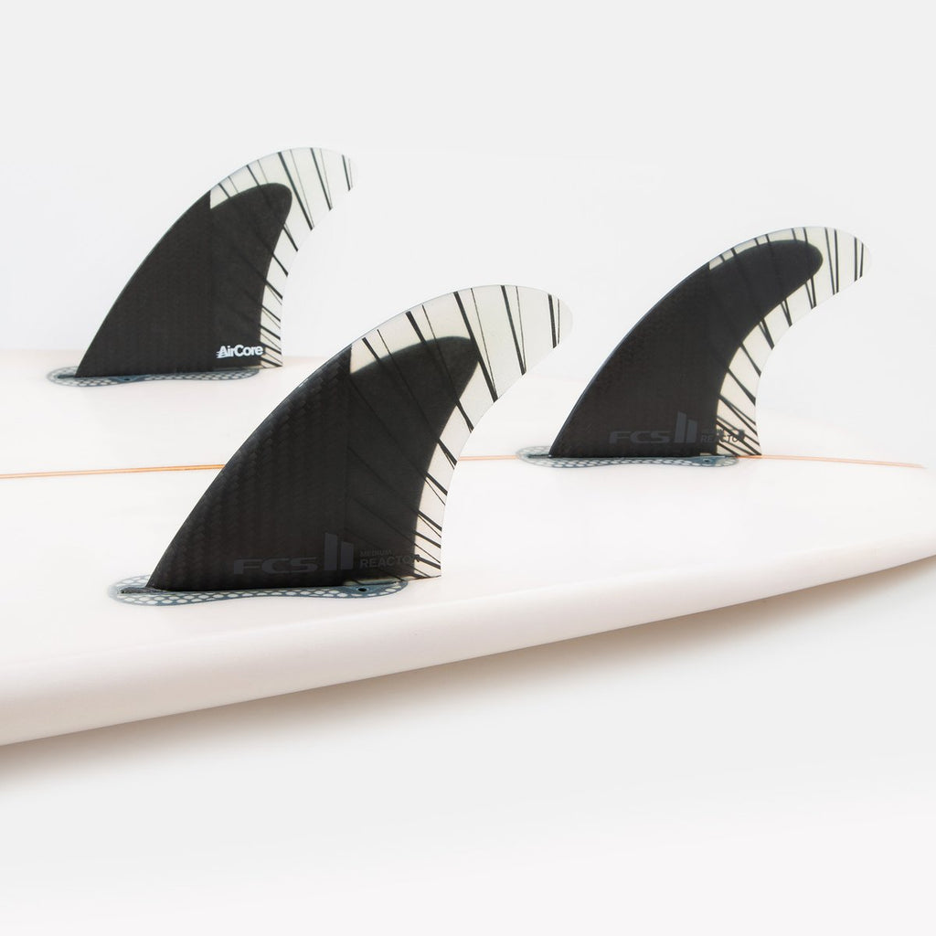 FCS II Reactor PC Carbon Thruster Fin Set On Surfboard