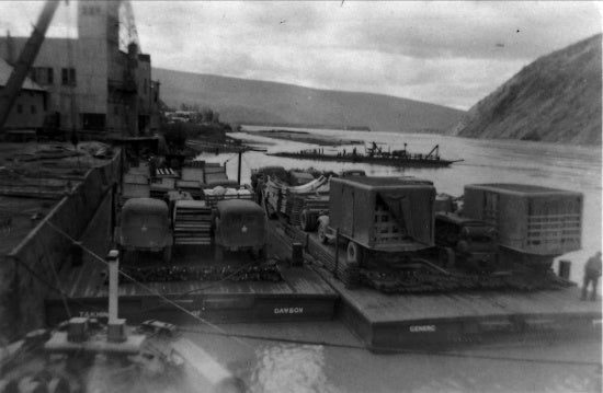 U.S. Army Equipment for Construction of the Alaska Highway at the dock in Dawson City, c1942.