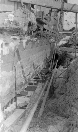 Excavation Along the Hull of Damaged Yukon Gold Company Dredge No. 1, 1913.