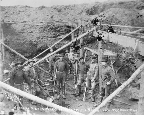 Group of Miners Working No. 6 Below Upper Discovery, Dominion Creek, c1900.