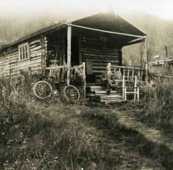 Robert Service at his Cabin c.1909.