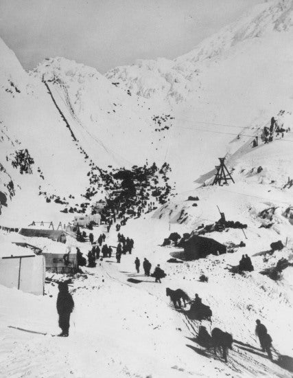 Climbing the Chilkoot Pass, c1898.