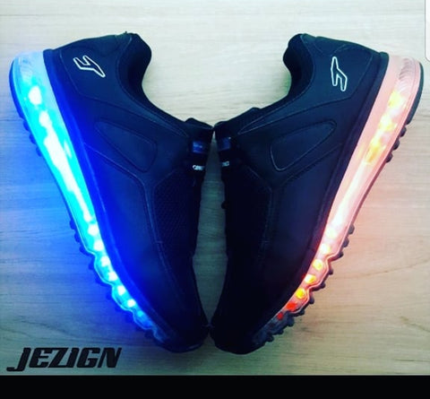 "All Black ""Comet"" with White, Red, and Blue illumination."