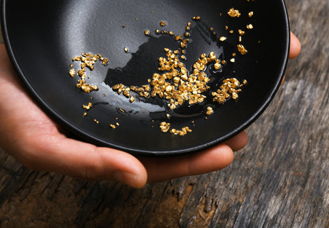 Fairmined gold pieces in a bowl.