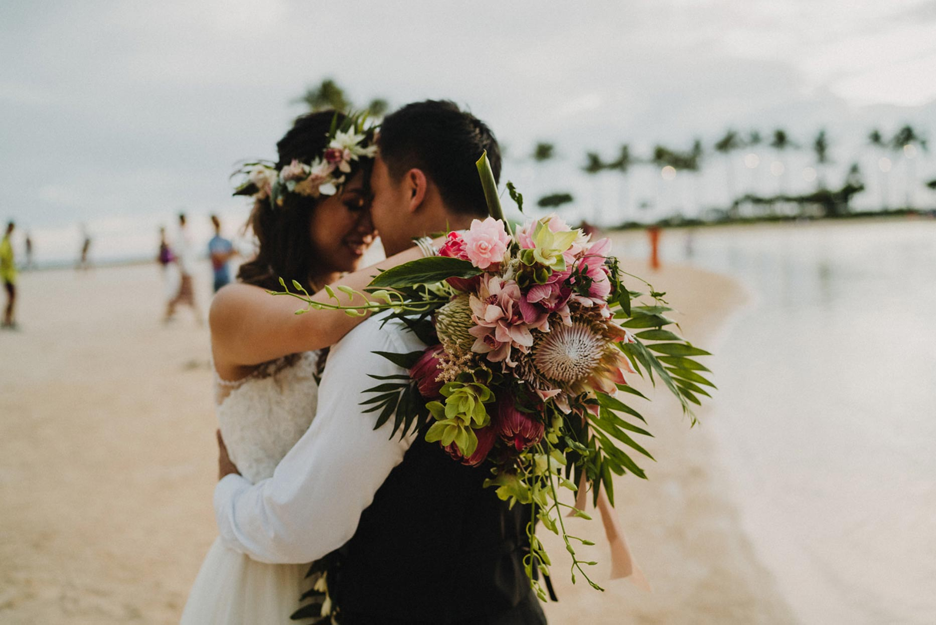 Bride and groom embracing on a beach