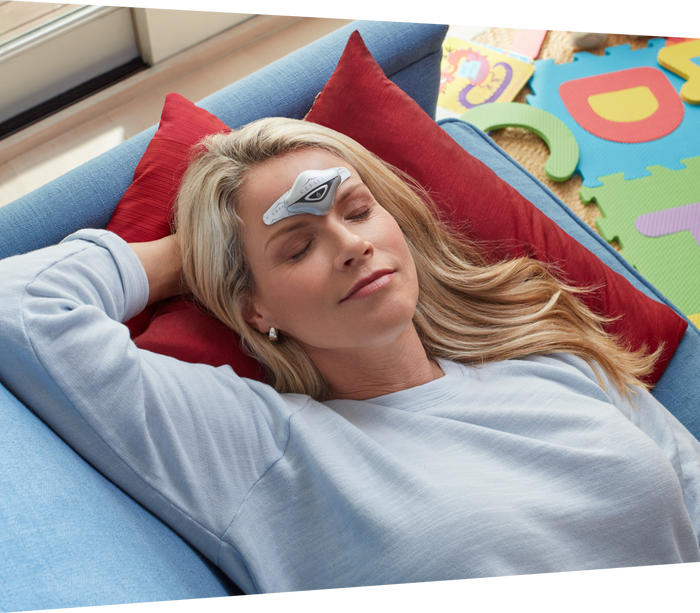 Woman practicing yoga while using her Cefaly device to prevent and treat her migraines