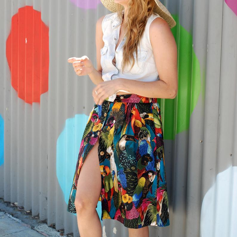 Knee-length a-line cotton button skirt with pockets in bird print