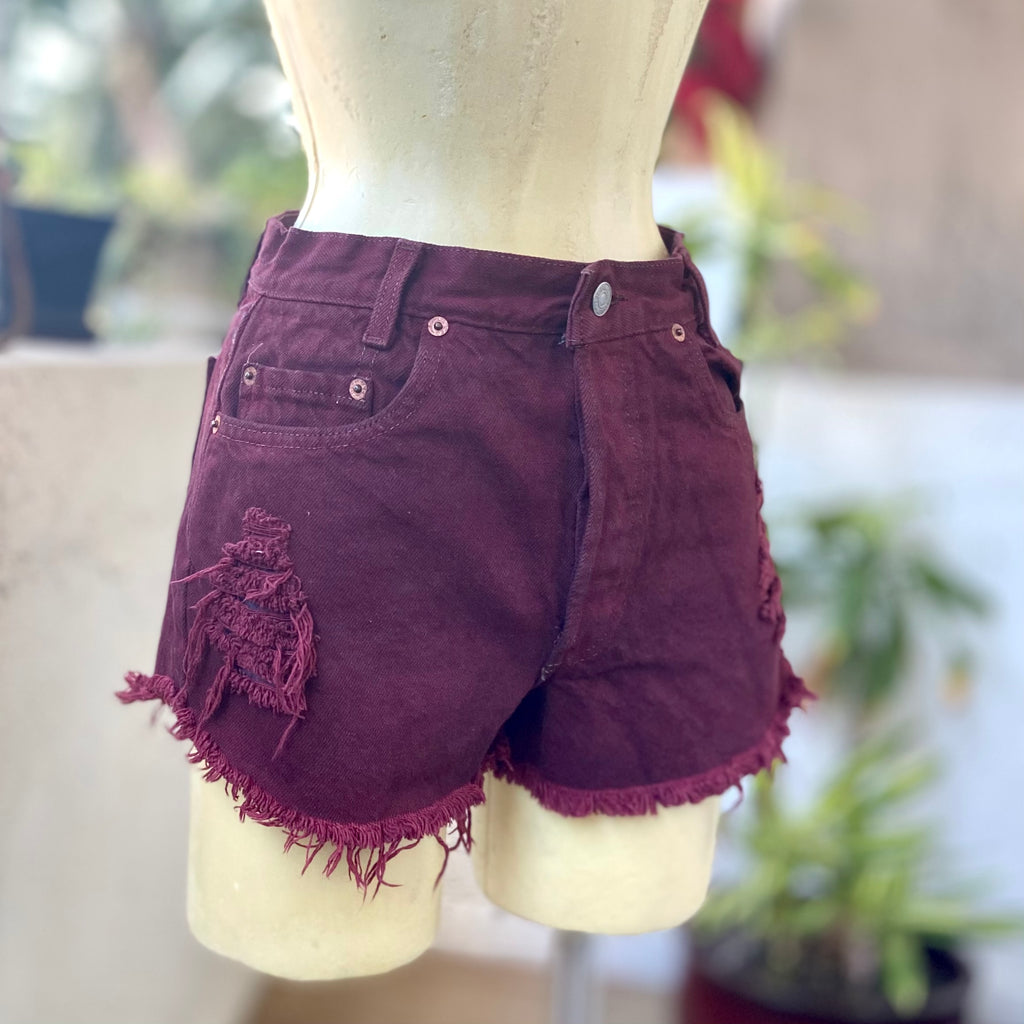 Deep red denim, frayed and distressed cut off short shorts